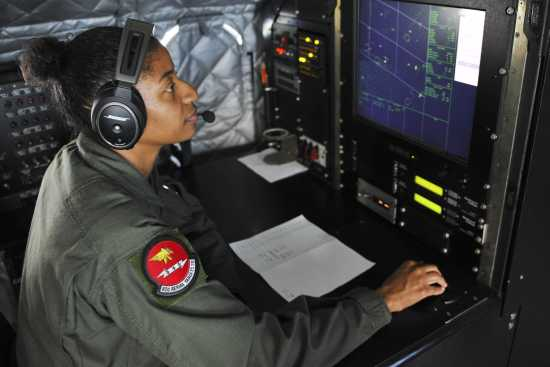 an Airborne Mission Systems Specialist at work