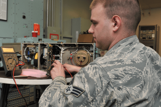 an Land Combat Electronic Missile System Repairer at work