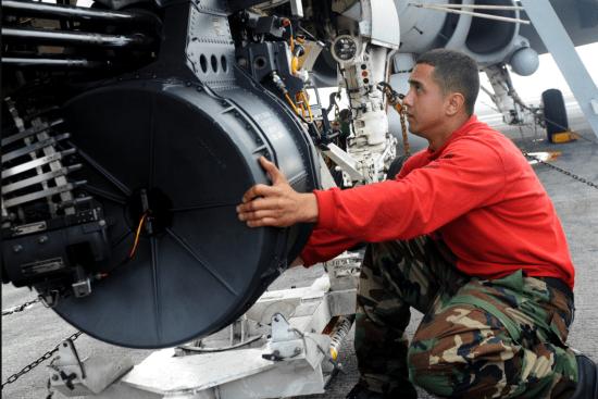 an Aviation Ordnanceman at work