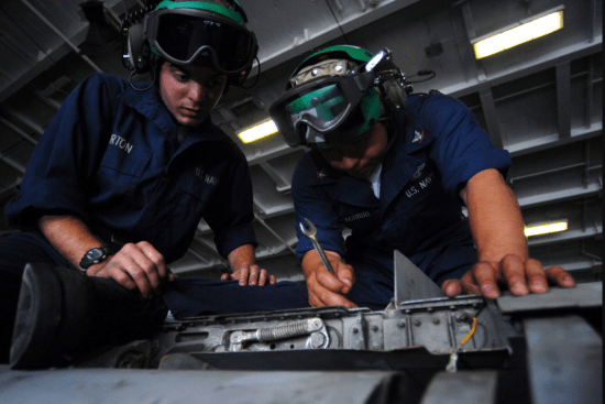 an Aviation Structural Mechanic at work