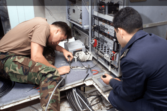an Electronics Technician at work