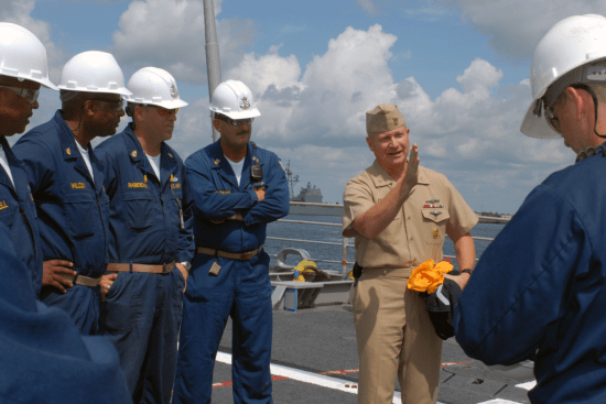 an Fleet, Force, and Navy Master Chief Petty Officer at work