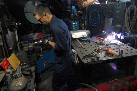 an Hull Maintenance Technician at work