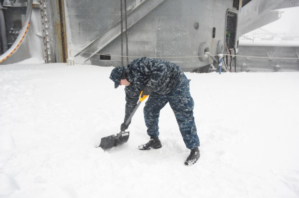 navy et shoveling snow
