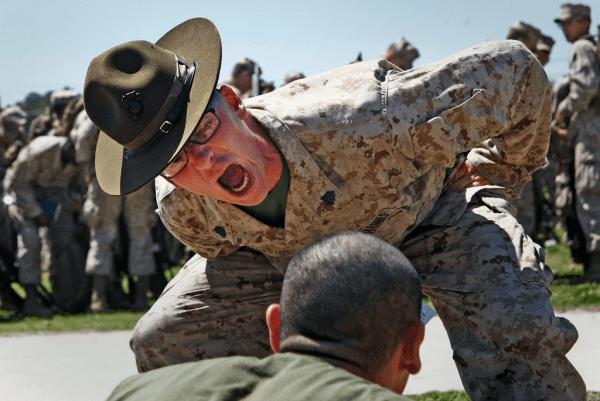 A Marine DI 'motivating' a recruit