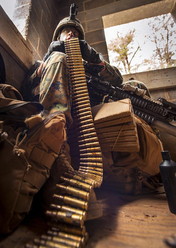 Marine Corps officer prepares his ammunition during The War field training exercise