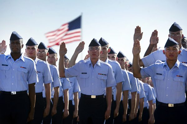 Airmen repeat the oath of enlistment at the basic training graduation ceremony