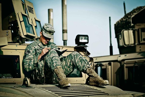 Soldier writing a letter home