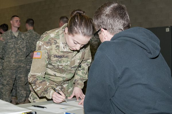 U.S. Army Pvt signs in at the beginning of drill at Training Site
