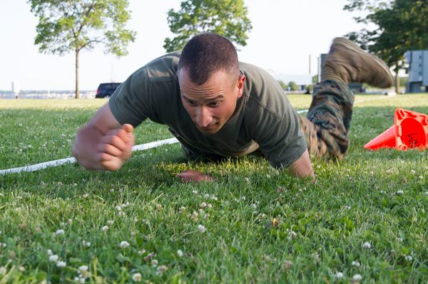 Marine executes a high crawl during the maneuver under fire portion of the Marine CFT
