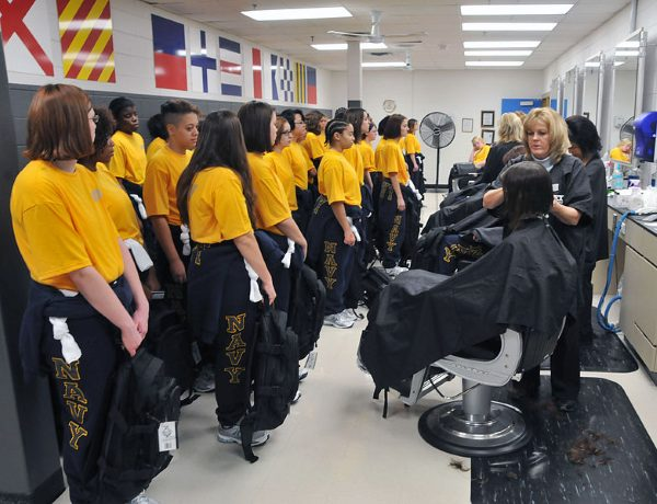 navy boot camp recruits receive their first haircut