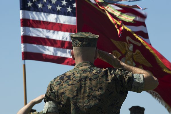 Marine salutes the flag according the the Marine General Orders