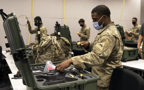 An Electronic Warfare Specialist in 1st Armored Division inventories assets