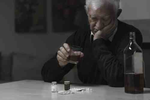 Alcohol addiction; Elderly man addicted to alcohol and drugs