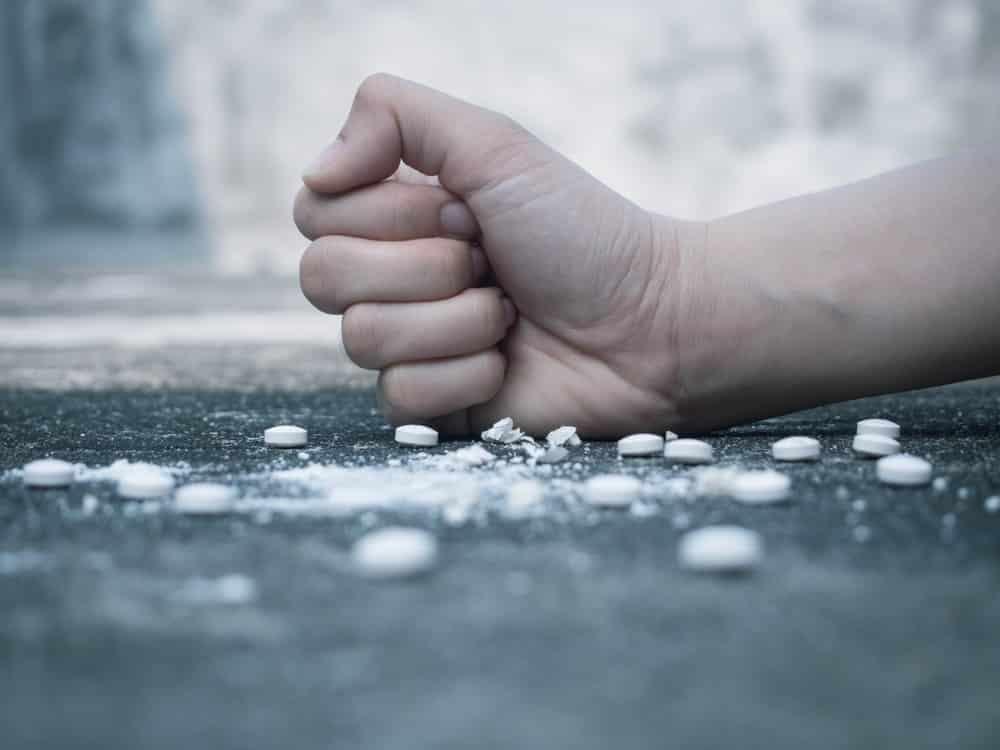 Hand crushing opiate prescription drugs