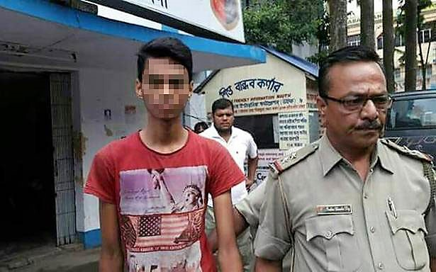 West Bengal police arresting the minor