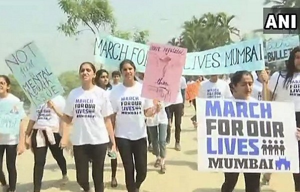 Mumbai residents take out a march to protest gun control laws in the US, leave people amused
