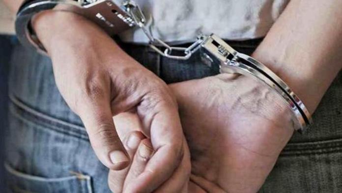 hands bound by Handcuffs.