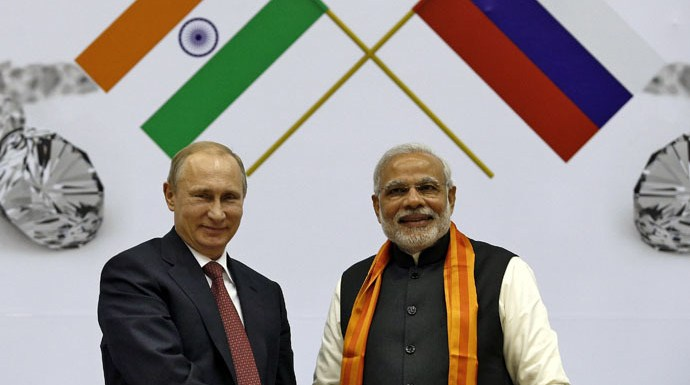 Modi and Putin shaking hands with two flags representing India and China on the background