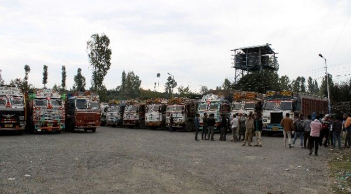 Truck drivers and apple traders suffer losses amidst security threat from Islamists targeting the apple business