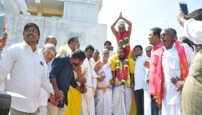 Dalit man carried on shoulders inside the temple by a priest in Telangana