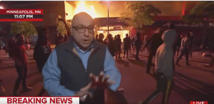MSNBC reporter says Minneapolis protest against death of George Floyd 'not unruly' while standing in front of a burning building amidst riots