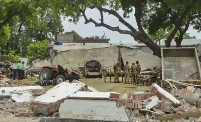 Police say large quantities of arms and ammunition found in a bunker and walls of Vikas Dubey's house