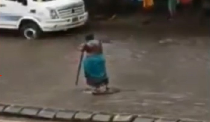 Kanta Murti was seen guarding a manhole in Matunga for 7 hours for the rising levels of water to recede