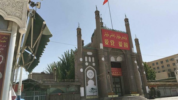 China has razed a mosque in Xinjiang and built a public toilet on the site, say reports