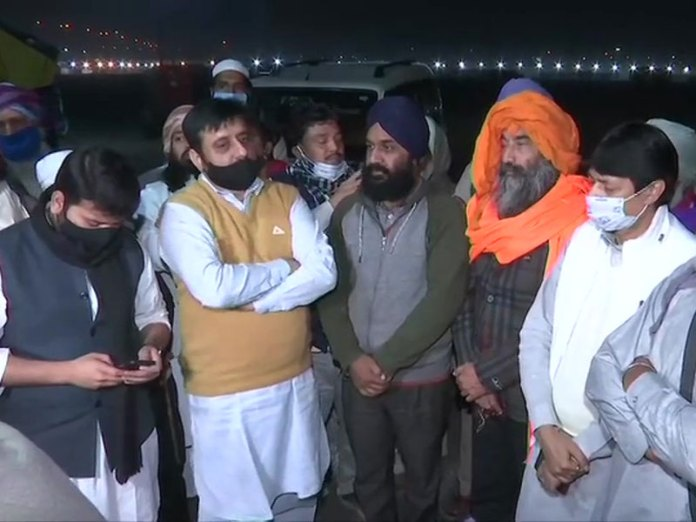 Amanatullah Khan with protesters
