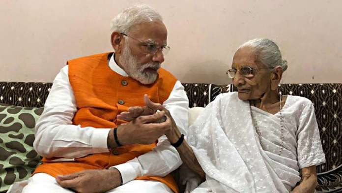 PM Modi's mother receives the first dose of Covid-19 vaccine
