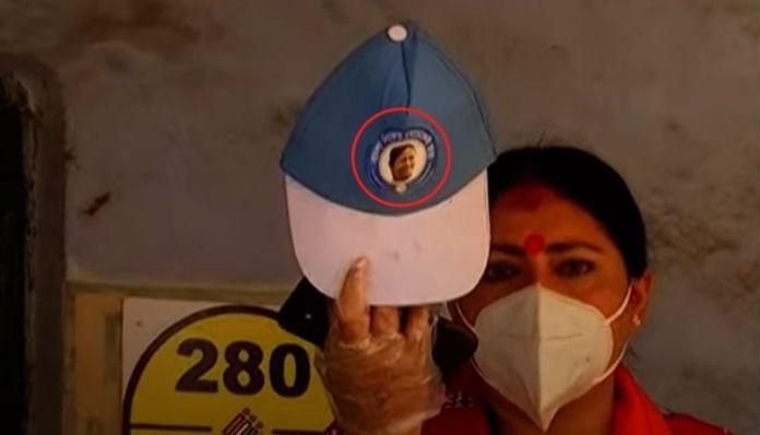 TMC agent violates EC rules by sporting cap with Mamata Banerjee's face