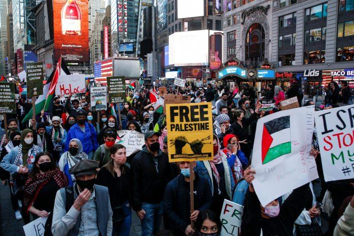Pro-Palestine groups gathered outside Israeli consulates and raised 'Free Palestine' slogans