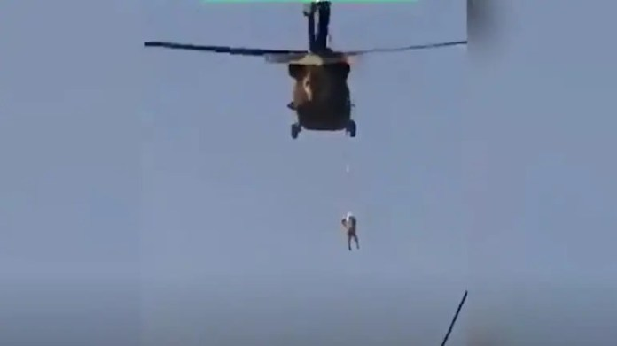 Shocking visuals show Taliban flying a US Black Hawk helicopter with a body hanging from it
