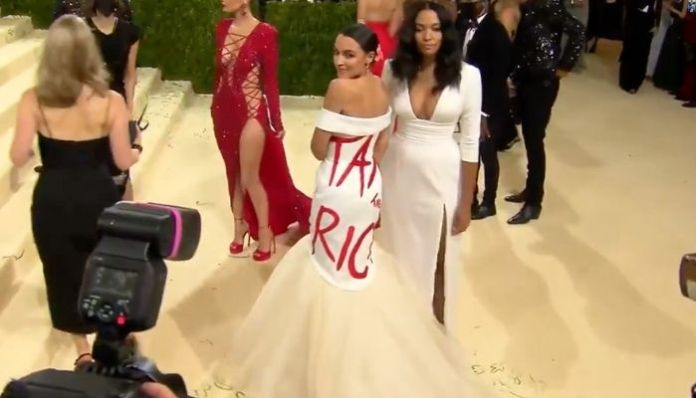 AOC shows up at MET Gala event wearing 'Tax the Rich' dress, gets slammed