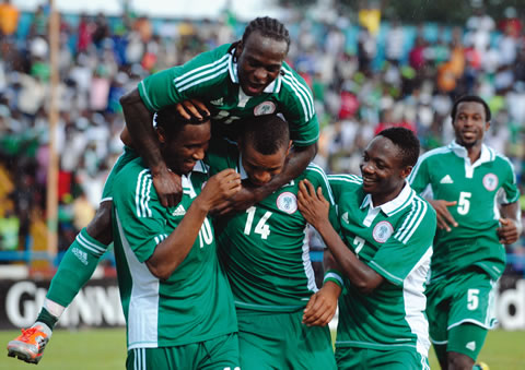 Half  a dozen of Super Eagle players rejoicing  after their second goal against Cote d'Ivoire.