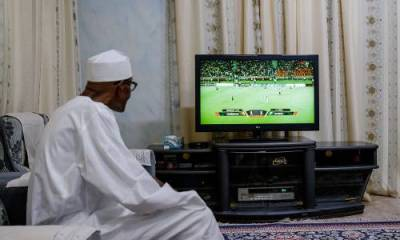 President Muhammadu Buhari watches the Nigeria Cameroon match