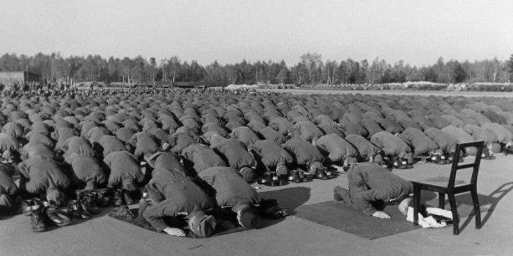 Muslim recruits of the SS Handzar Division pray in 1943. HARVARD UNIVERSITY PRESS; GERMAN ARCHIVES