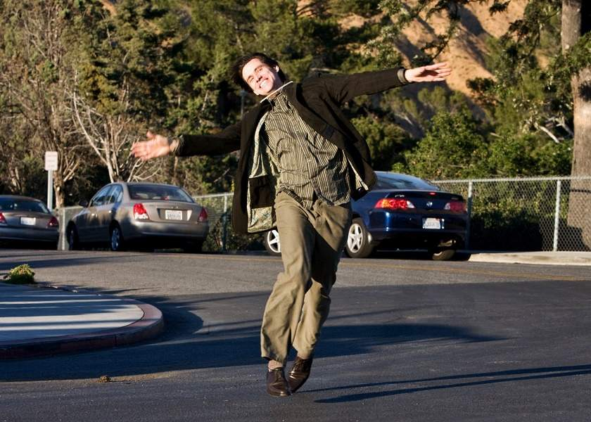 Jim Carrey is ectastic and happy and walks in Yes Man