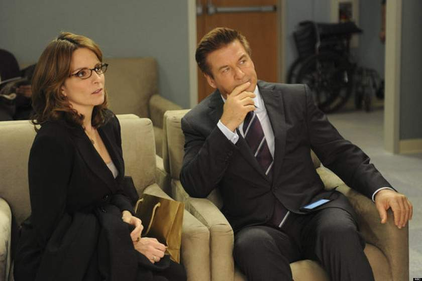 two workers listen to some talking, tina fey, alec baldwin 30 rock