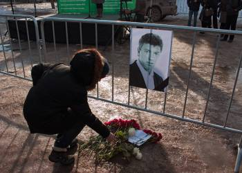 People layered flowers to a picture of opposition leader Boris Nemtosv, shot dead on february 27, 2015. Picture by Igor Titarenko.