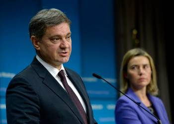 Bosnia-Herzegovina's Prime Minister Denis Zvizdic (L) talks to the media next to European Union High Representative for Foreign Affairs and Security Policy Federica Mogherini (R) at the end of an EU/Bosnia-Herzegovina Stabilisation and Association Council held at the European Union Council building in Brussels on December 11, 2015.  / AFP / THIERRY CHARLIER