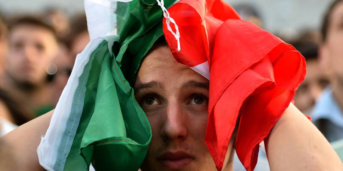 An Italy fan reacts as he watches the FIFA World Cup 2014 Group D football match Italy vs Uruguay on a giant screen in central Rome on June 24 , 2014. AFP PHOTO / ALBERTO PIZZOLI / AFP / ALBERTO PIZZOLI