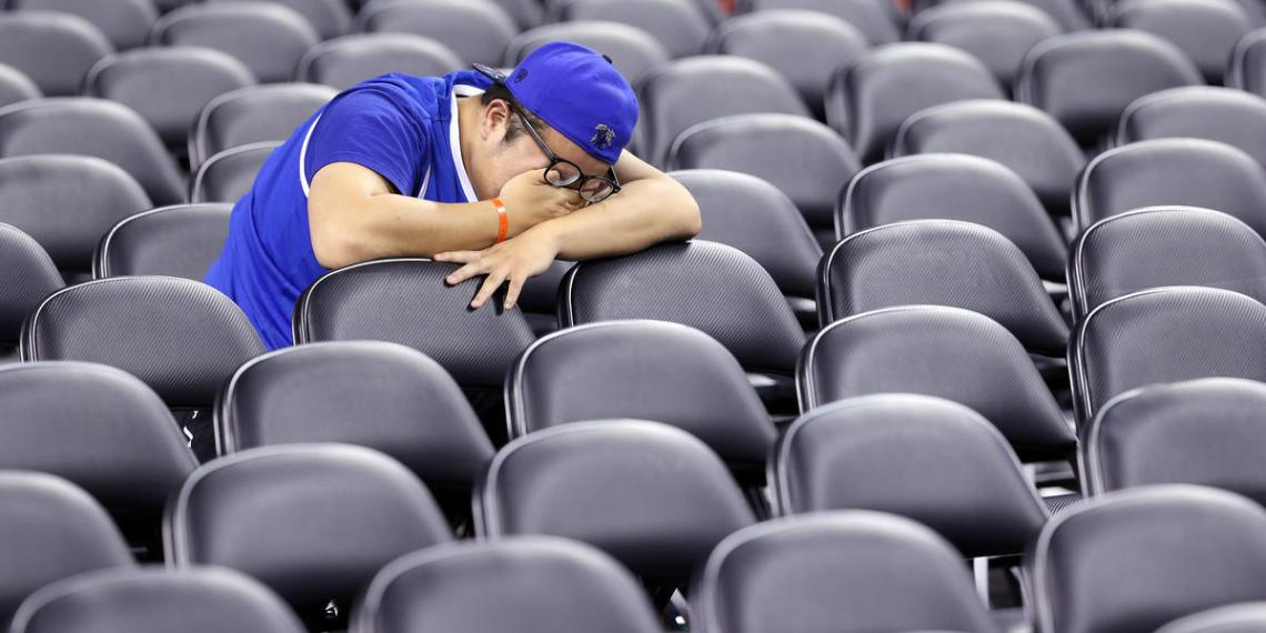 INDIANAPOLIS, IN - APRIL 04: A Kentucky Wildcats fan reacts in the stands after being defeated by the Wisconsin Badgers during the NCAA Men's Final Four Semifinal at Lucas Oil Stadium on April 4, 2015 in Indianapolis, Indiana. Wisconsin defeated Kentucky 71-64.   Andy Lyons/Getty Images/AFP