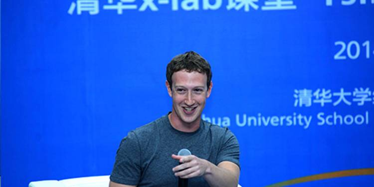 "This picture taken on October 22, 2014, released by Tsinghua University , shows the head of US based internet company Facebook, Mark Zuckerberg (L)  delivering a speech as he was named to the advisory board of Tsinghua's School of Economics and Management in Beijing. Facebook is blocked in China, but its co-founder Mark Zuckerberg appears determined to win over hearts and minds in Beijing -- surprising a hall full of students by conducting a Q&A session in Mandarin. AFP PHOTO / TSINGHUA UNIVERSITY----EDITORS NOTE---- RESTRICTED TO EDITORIAL USE - MANDATORY CREDIT ""AFP PHOTO / TSINGHUA UNIVERSITY"" - NO MARKETING NO ADVERTISING CAMPAIGNS - DISTRIBUTED AS A SERVICE TO CLIENTS / AFP / TSINGHUA UNIVERSITY / TSINGHUA UNIVERSITY"
