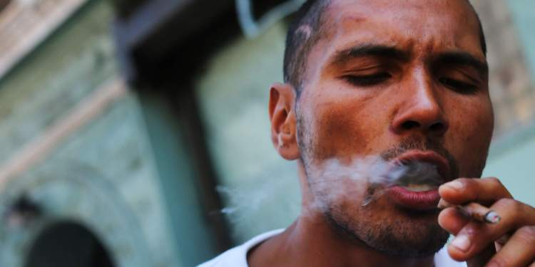 """NEW YORK, NY - AUGUST 05: A man smokes K2 or """"Spice"""", a synthetic marijuana drug, along a street in East Harlem on August 5, 2015 in New York City. New York, along with other cities, is experiencing a deadly epidemic of synthetic marijuana usage including varieties known as K2 or """"Spice"""" which can cause extreme reactions in some users. According to New York's health department, more than 120 people visited an emergency room in the city in just one week in April. While the state banned the ingredients used to make K2 in 2012, distributors have switched to other ingredients and names in an attempt to circumvent the law.   Spencer Platt/Getty Images/AFP"""