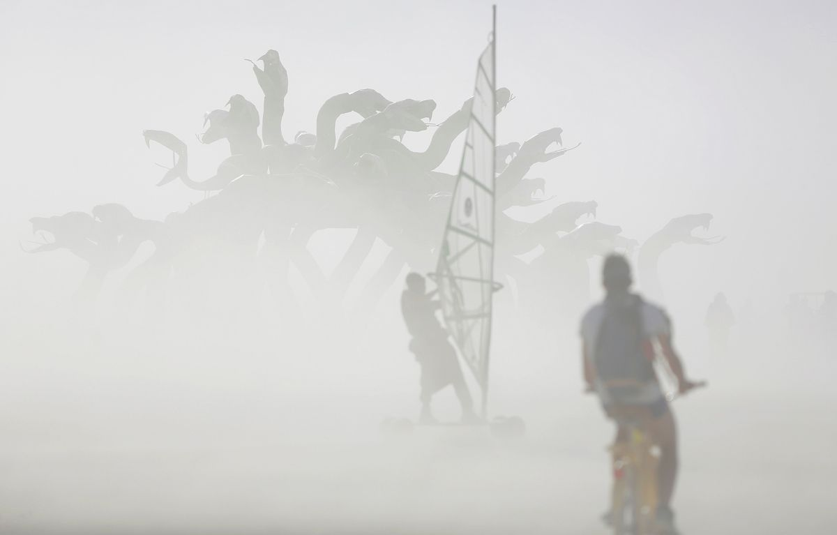 Dust blows past an art installation as approximately 70,000 people from all over the world gather for the 30th annual Burning Man arts and music festival in the Black Rock Desert of Nevada, U.S. August 30, 2016. Picture taken August 30, 2016. REUTERS/Jim Urquhart FOR USE WITH BURNING MAN RELATED REPORTING ONLY. FOR EDITORIAL USE ONLY. NOT FOR SALE FOR MARKETING OR ADVERTISING CAMPAIGNS. NO THIRD PARTY SALES. NOT FOR USE BY REUTERS THIRD PARTY DISTRIBUTORS. - RTX2NPPF