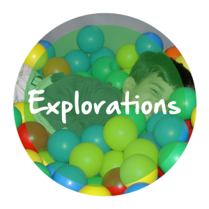 "The word ""Explorations"" appears in white text over a transparent green circle resting atop a picture of a small child playing in a ball pit."