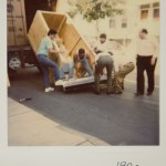 Living without a loading dock, Optikos employees load product onto a crate for shipment - 1992
