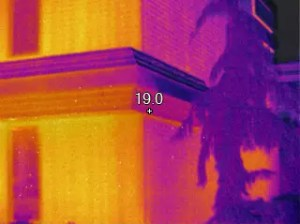 Image shows mansard roof holding excessive moisture, lower level in image, upper right portion of roof.